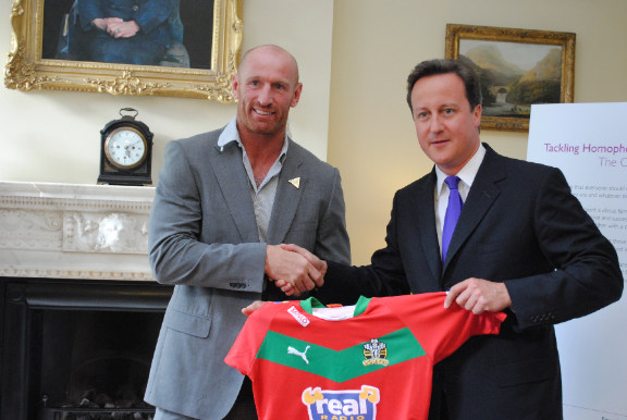 Rugby player Gareth Thomas (left) with David Cameron at an LGTB reception at No.10 to launch a new campaign to kick homophobia and transphobia out of sport. 21 June 2011.